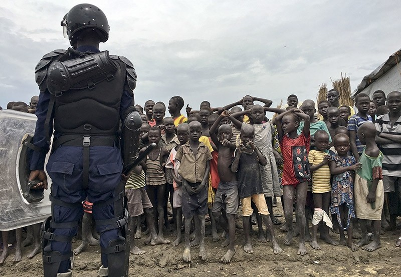 A crowd of displaced people look on in South Sudan's largest camp for the internally-displaced, in Bentiu (AP Photo)