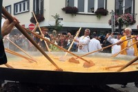 About a thousand people flocked to the small Belgian town of Malmedy on Tuesday to eat a giant omelette made of 6,500 eggs, despite the country being at the center of a scandal involving tainted...