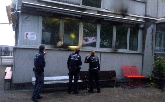 Police officers examining the damage to the mosque. AA Photo
