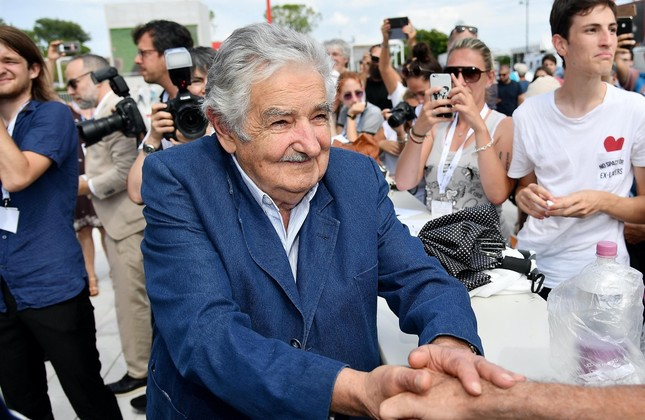 Former Uruguayan President Jose Mujica signs autographs and shakes hands of fans as he arrives for the premiere of 'El Pepe, Una Vida Suprema.""