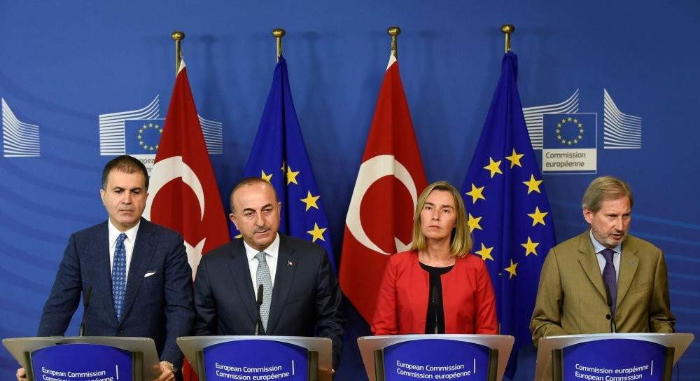 EU Affairs Minister u00d6mer u00c7elik, Foreign Minister Mevlu00fct u00c7avuu015fou011flu, EU Foreign Policy Chief Federica Mogherini and European Commissioner for Enlargement Johannes Hahn give a joint press conference