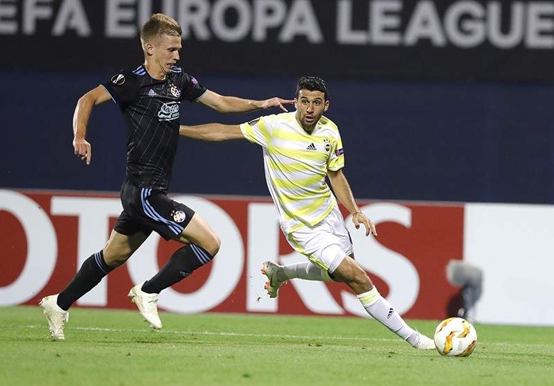 Fenerbahu00e7e's Mehmet Topal (R) in action against Dinamo's Mario Gavranovic (L) during the UEFA Europa League' group  D soccer match between FC Fenerbahce  and GNK Dinamo Zagreb at Maksimir stadium in Zagreb, Sept. 20, 2018.