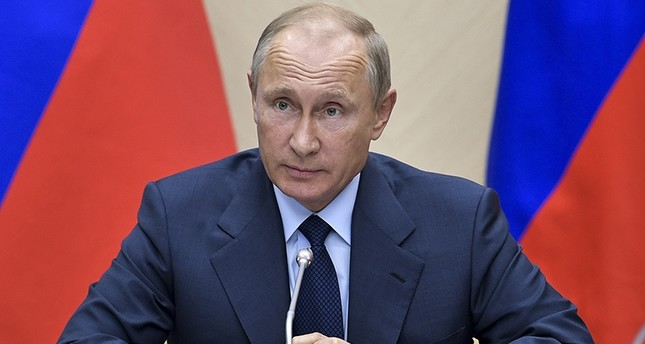 Russian President Vladimir Putin speaks during a meeting at the Novo-Ogaryovo residence outside Moscow, Russia, Sept. 27, 2017. (AP Photo)