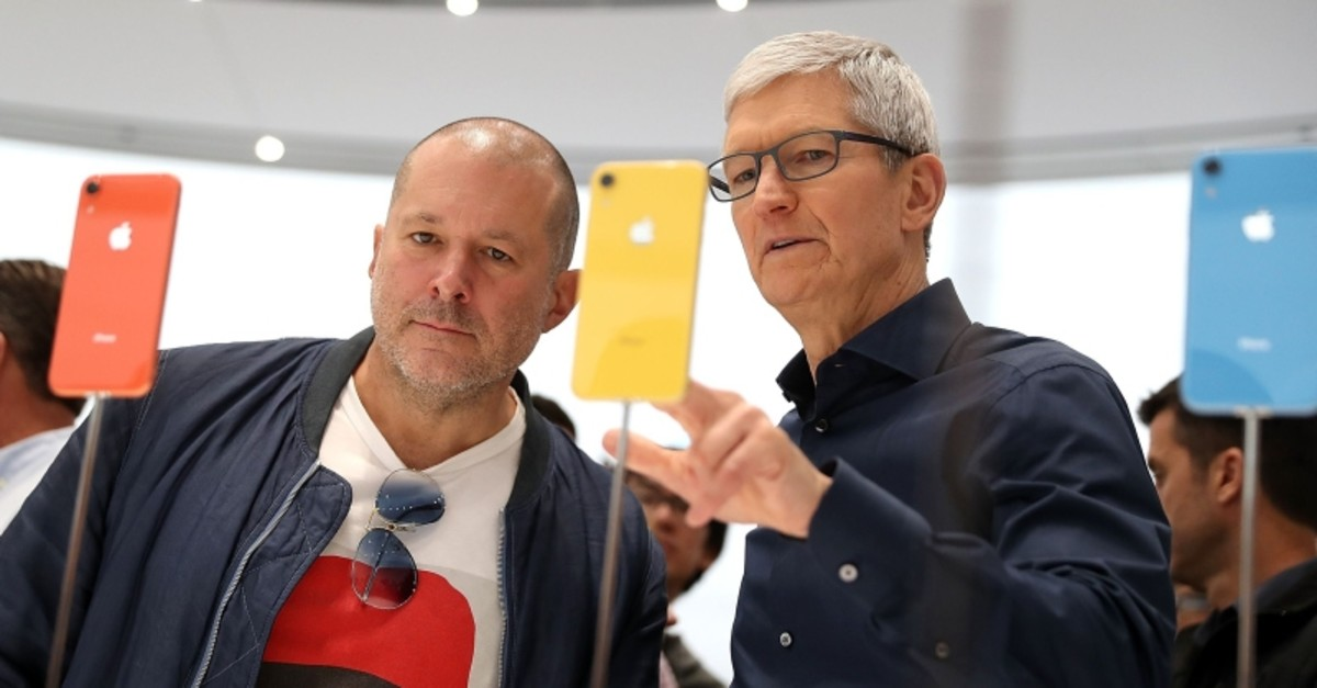 In this file photo taken on September 12, 2018 Apple chief design officer Jony Ive (L) and Apple CEO Tim Cook inspect the iPhone XR during an Apple special event at the Steve Jobs Theatre in Cupertino, California. (AFP Photo)
