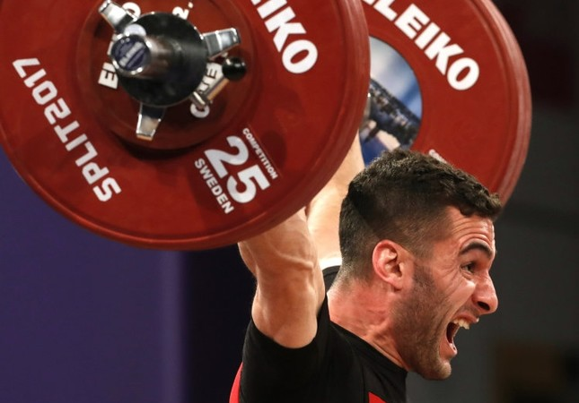 Hurşit Atak of Turkey makes an attempt during the Men's Final 62 kilogram competition of  the Weightlifting European Championships 2017 in Split, Croatia.