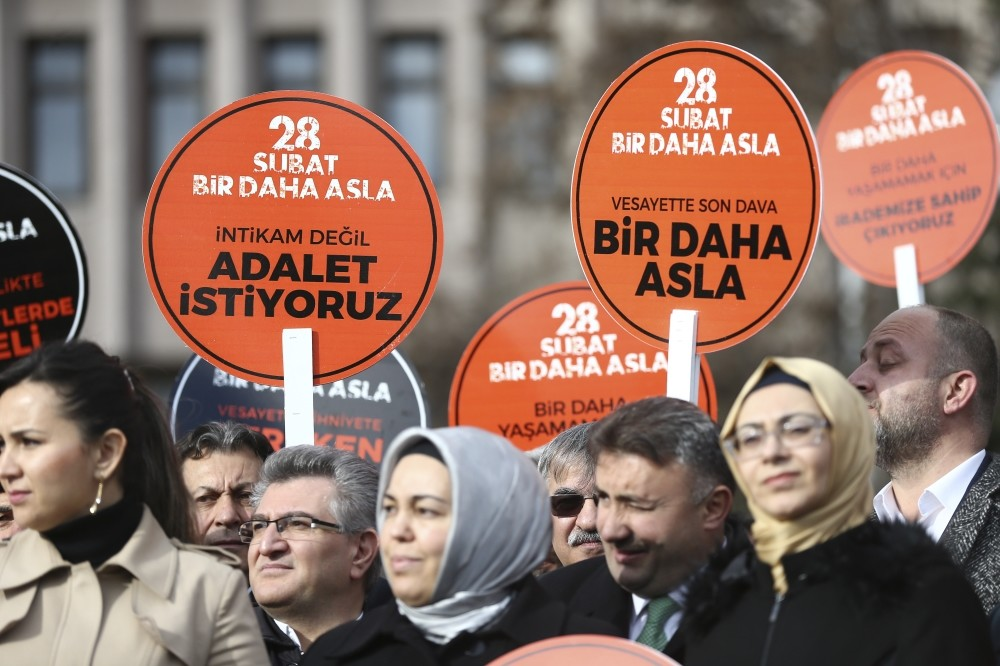 Activists hold placards reading ,Feb. 28, Never Again, We Want Justice, Not Revenge,, outside the Ankara courthouse where defendants accused of the coup are on trial.