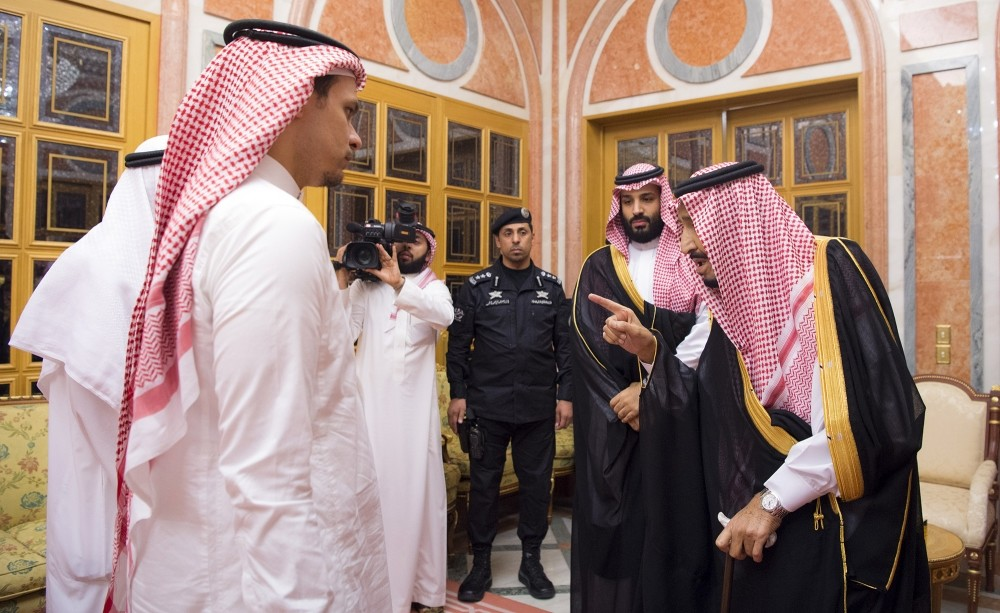 Saudi King Salman (R) and Crown Prince Mohammed bin Salman (2-R) meet with Salah bin Jamal Khashoggi (L), son of murdered Saudi journalist Jamal Khashoggi, in Riyadh, Saudi Arabia, Oct. 23.