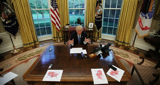 President Trump speaks during an interview with Reuters in the Oval Office of the White House in Washington, D.C., April 27.