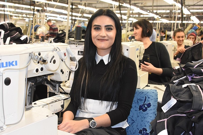A Turkish woman in Edirne province works in a textile factory. (DHA Photo)