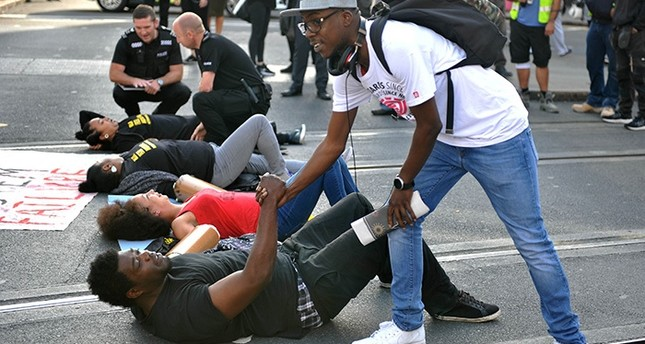 The U.S.-based group Black Lives Matter have blocked a road leading to Heathrow Airport, and Nottinghamand city centre and in other British cities (AP Photo)