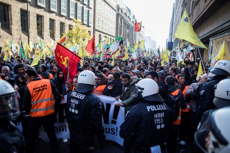PKK sympathizers hold  banners demanding 'Freedom for u00d6calan' during a protest in Duesseldorf, Germany, Saturday, Nov. 4, 2017. (AP Photo)
