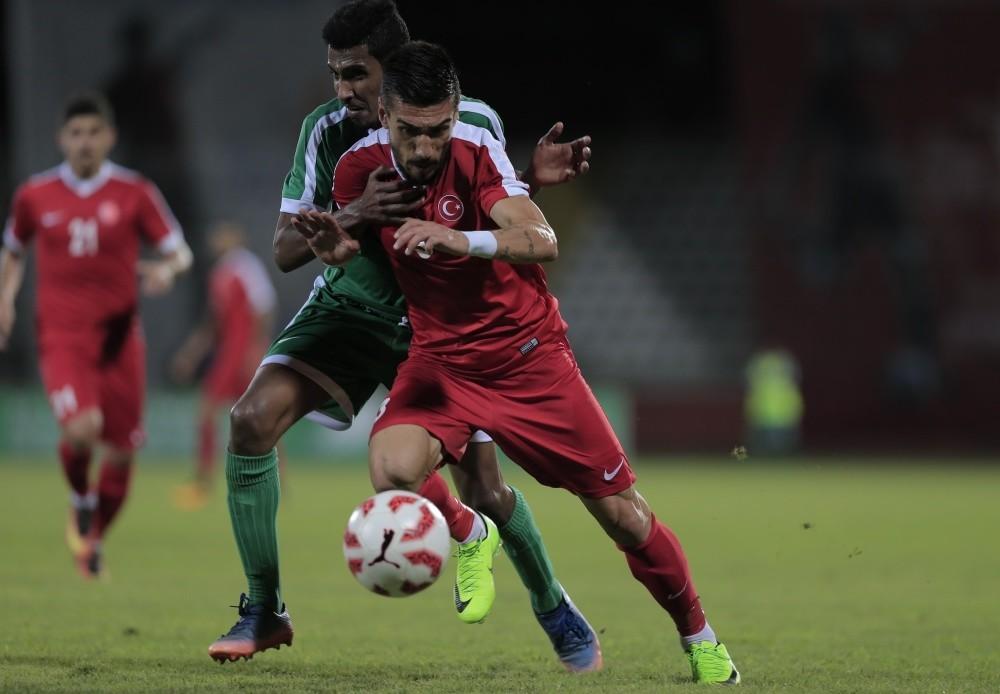Turkeyu2019s Murat u015eimu015fek vies for the ball during the match between Turkey and Saudi Arabia in Samsun.