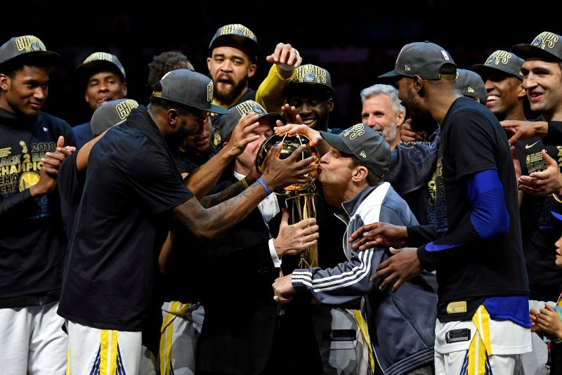 Warriors owner Peter Guber kisses the Larry O'Brien Championship Trophy after beating the Cleveland Cavaliers in game four of the 2018 NBA Finals at Quicken Loans Arena. (Reuters Photo)