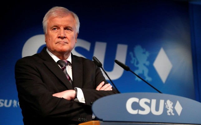 In this Oct. 15, 2018 file photo German Interior Minister and CSU chairman Horst Seehofer attends a press conference at the headquarters of the Christian Social Union, CSU, in Munich, Germany. (AP Photo)