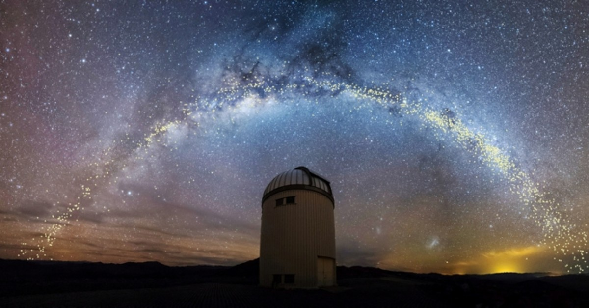 The warped shape of the stellar disk of the Milky Way galaxy, determined by mapping the distribution of young stars called Cepheids with distances set out in light years, is seen over the Warsaw University Telescope  (Reuters Photo)