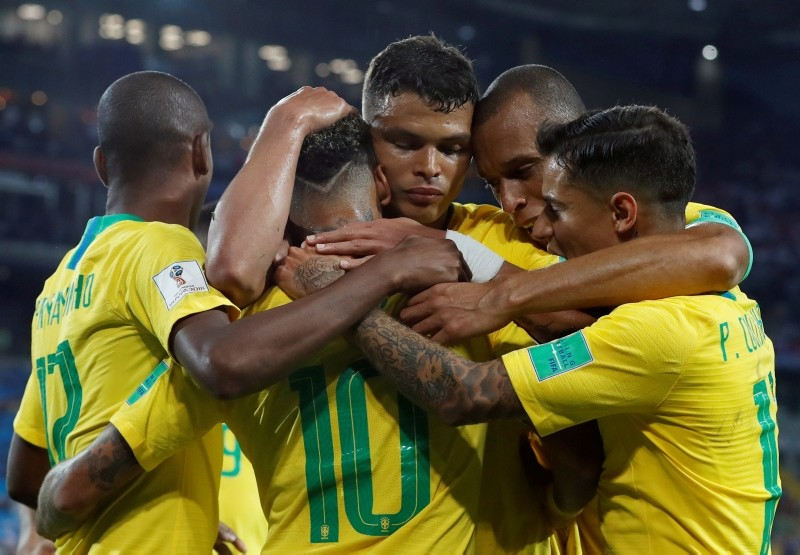 Brazil's players celebrates after teammate Brazil's Thiago Silva scoring his site's second goal during the group E match between Serbia and Brazil. (AP Photo)