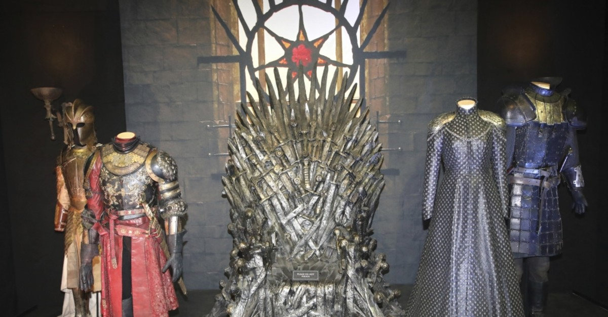 The Iron Throne and costumes on display during the launch of The Game of Thrones Touring Exhibition at the Titanic Exhibition center in Belfast, Ireland April 10, 2019.