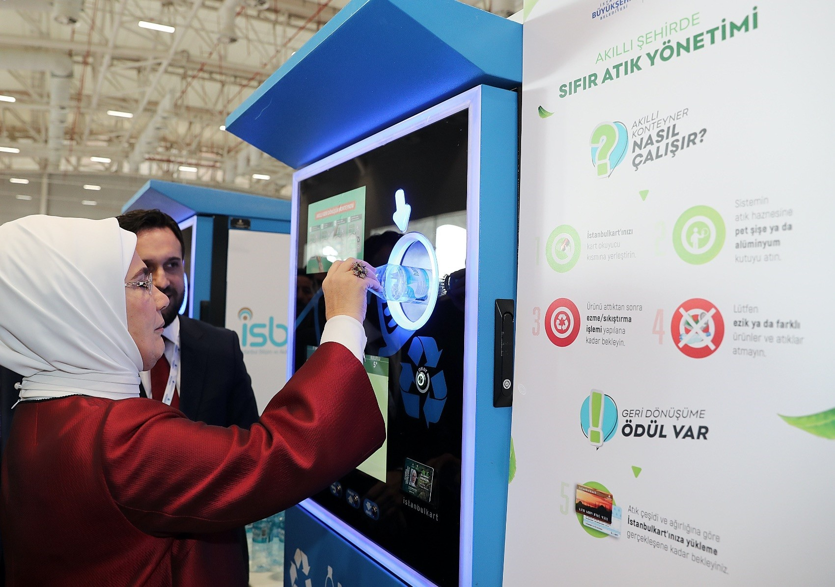 First lady Emine Erdou011fan deposits a plastic bottle to a u201csmart waste transfer machineu201d that gives mass transit credits in exchange for plastic bottles during an event on the environment in Istanbul in December.