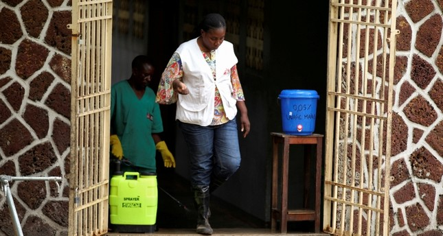 A Medecins Sans Frontieres (MSF) worker walks from an isolation facility, prepared to receive suspected Ebola cases, at the Mbandaka General Hospital, in Mbandaka, Democratic Republic of Congo May 20, 2018. (REUTERS Photo)