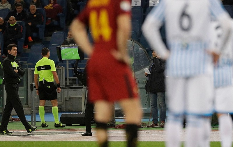 In this Dec. 1st, 2017 file photo, referee Rosario Abisso, second from left, checks the Video Assistant Referee (VAR) during an Italian Serie A soccer match between AS Roma and Spal, at the Olympic stadium in Rome. (AP Photo)