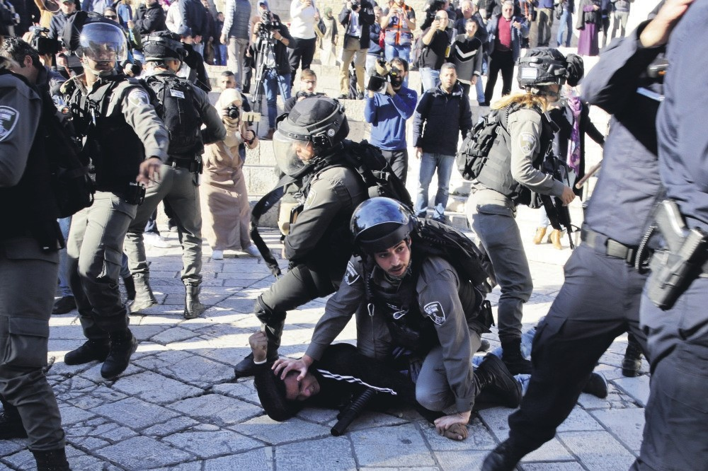 Israeli border police arrest a Palestinian during a protest against the U.S. recognition of Jerusalem as the capital of Israel at Damascus Gate in Jerusalem's Old City, Dec. 8.