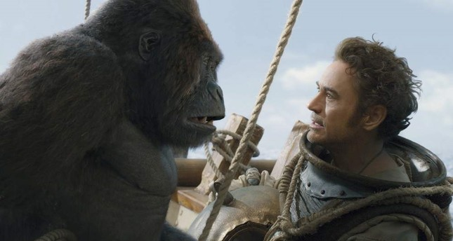 This image released by Universal Pictures shows Chee-Chee, voiced by Rami Malek, left, and Dr. John Dolittle, portrayed by Robert Downey Jr. in a scene from Dolittle. AP Photo