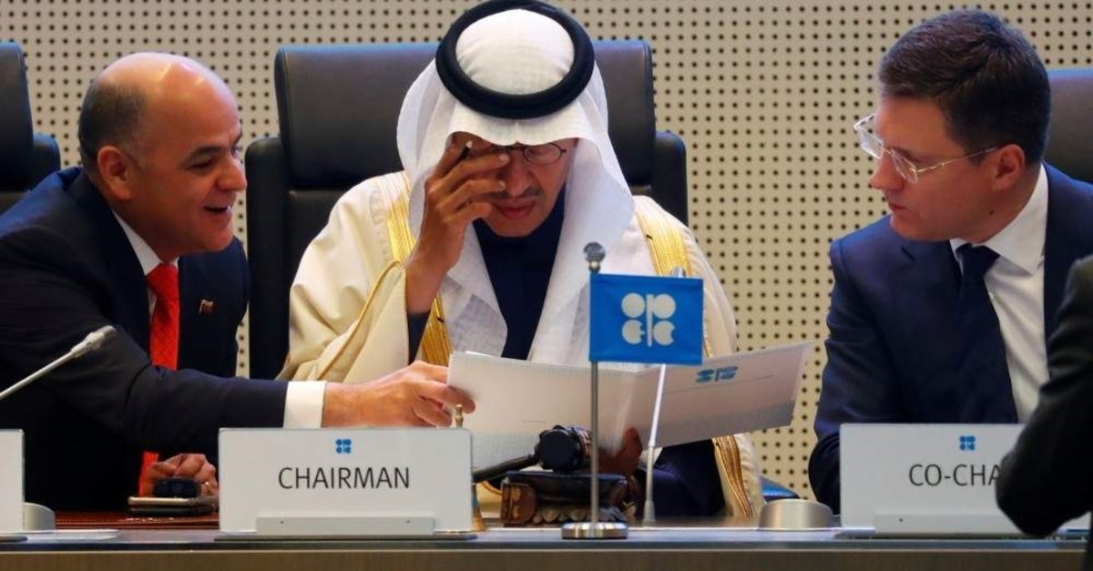 Venezuelan Oil Minister Manuel Quevedo (L), Saudi Energy Minister Prince Abdulaziz bin Salman Al Saud (C) and Russia's Energy Minister Alexander Novak are seen at the beginning of an OPEC and non-OPEC meeting in Vienna, Dec. 6, 2019. (Reuters Photo)