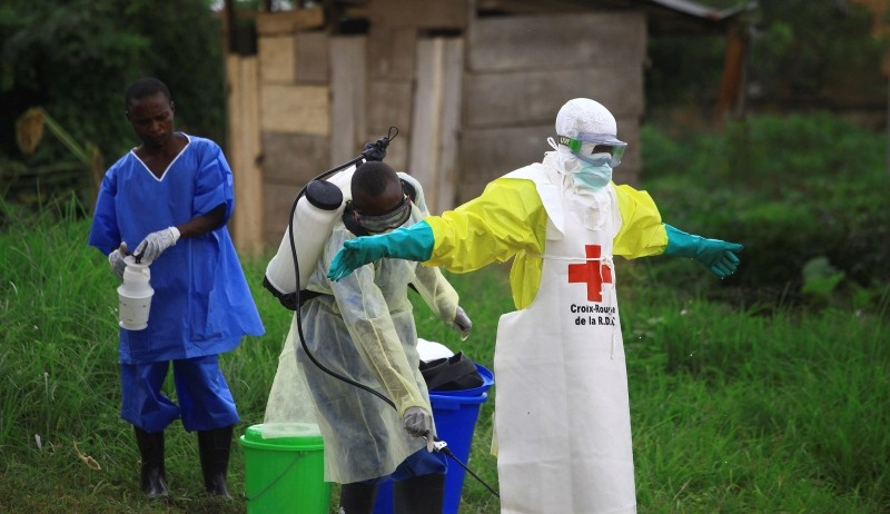 In this Sunday, Sept 9, 2018 file photo, a health worker sprays disinfectant on his colleague after working at an Ebola treatment centre in Beni, Eastern Congo. (AP Photo)