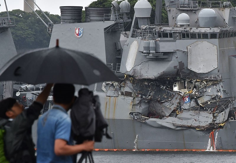 A TV crew films the damages on the guided missile destroyer USS Fitzgerald at its mother port in Yokosuka, southwest of Tokyo on June 18, 2017. (AFP Photo)