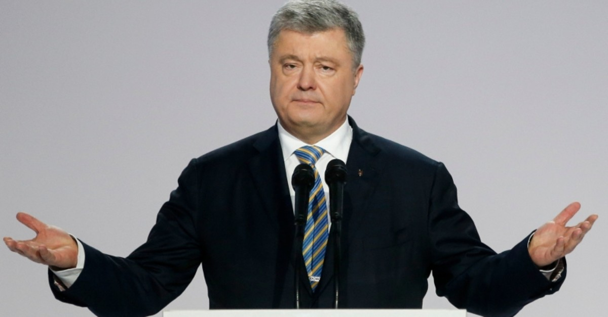 In this file photo dated Tuesday, Jan. 29, 2019, Ukrainian President Petro Poroshenko gestures while speaking at a meeting with supporters in Kiev, Ukraine. (AP Photo)