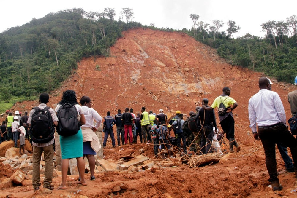 Volunteers stand at the scene of heavy flooding and mudslides in Regent, just outside of Sierra Leone's capital Freetown. (AP Photo)