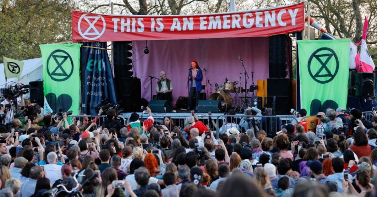 Swedish climate change activist Greta Thunberg (C) speaks at the Extinction Rebellion group's environmental protest camp at Marble Arch in London. (AFP Photo)