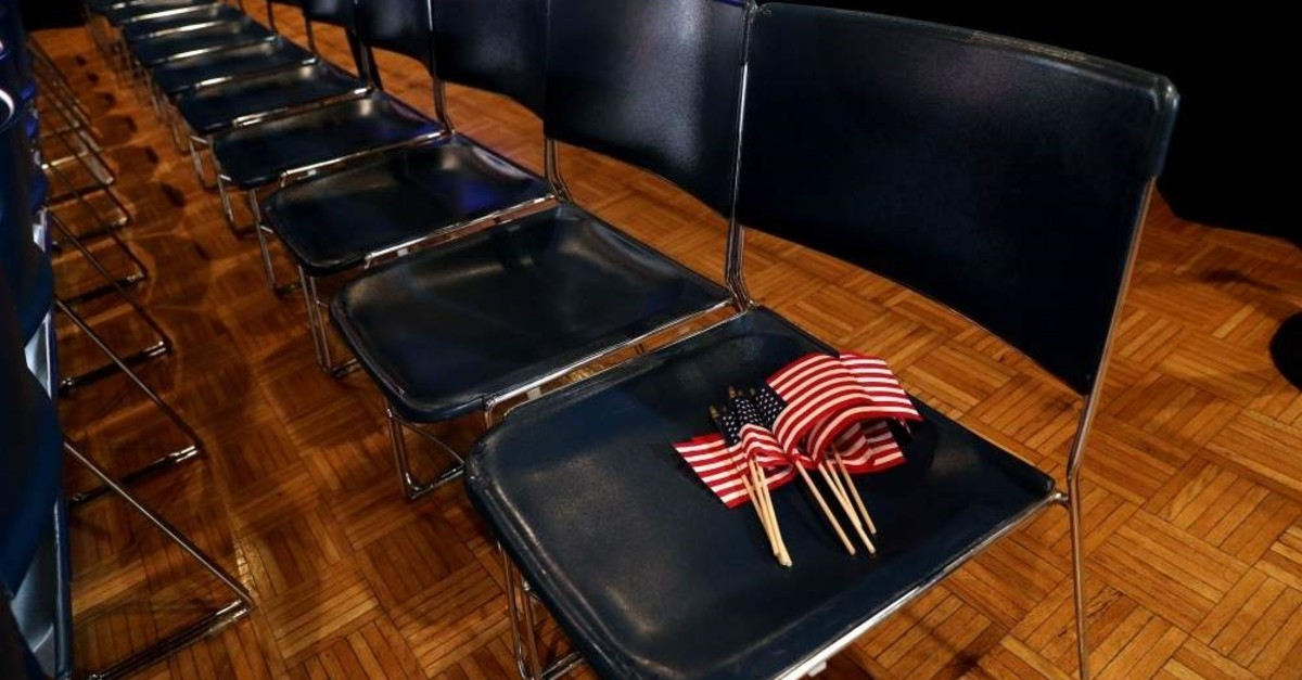 Flags are left on a seat before a rally by former Vice President Joe Biden in Des Moines, Iowa, U.S., Feb. 3, 2020. (Reuters Photo)