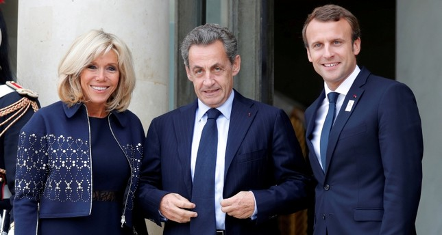 French President Emmanuel Macron (R) and his wife Brigitte Macron greet former French president Nicolas Sarkozy for a ceremony at the Elysee Palace, September 15, 2017. (Reuters Photo)