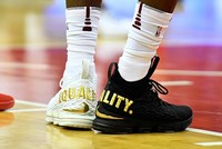 LeBron James made a statement during an NBA game with his shoes — one black, one white, with the word