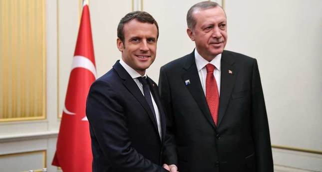 Macron (L) and Erdoğan shake hands ahead of a meeting on the sidelines of the NATO summit in Brussels, Belgium, May 25, 2017. (AFP Photo)