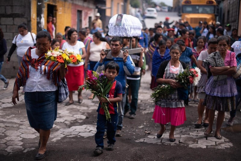 Funeral procession for Alexis Chavez Garcia, a 9 month-old baby who died due to the explosion of the Fuego Volcano, in Alotenango, Guatemala, June 16, 2018. (EPA Photo)