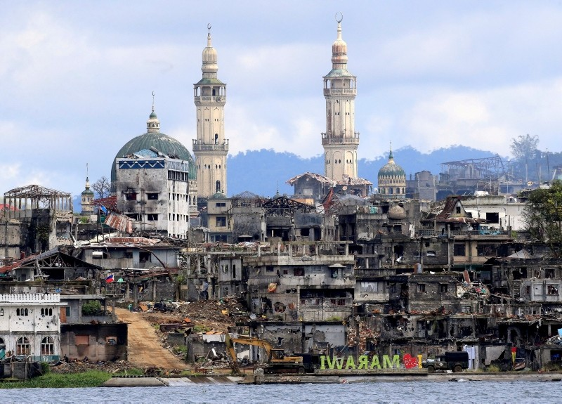 This Oct. 26, 2017 file photo shows a signage of ,I love Marawi, in front of damaged houses, buildings and a mosque inside a war-torn Marawi city, southern Philippines. (Reuters Photo)