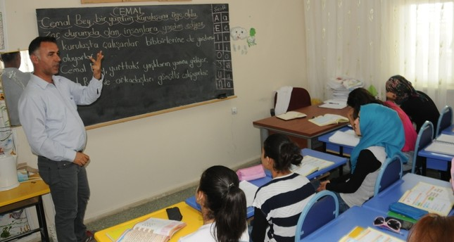 Syrian women attend Turkish language classes offered by the local education authority in the southeastern city of Batman. Turkey already offers language courses for Syrians, but they are mostly confined to children of school age.