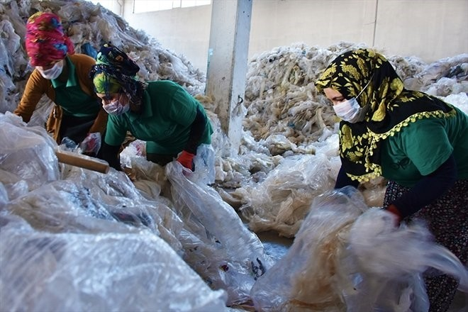 Local women sort out the garbage before the recycling process begins.