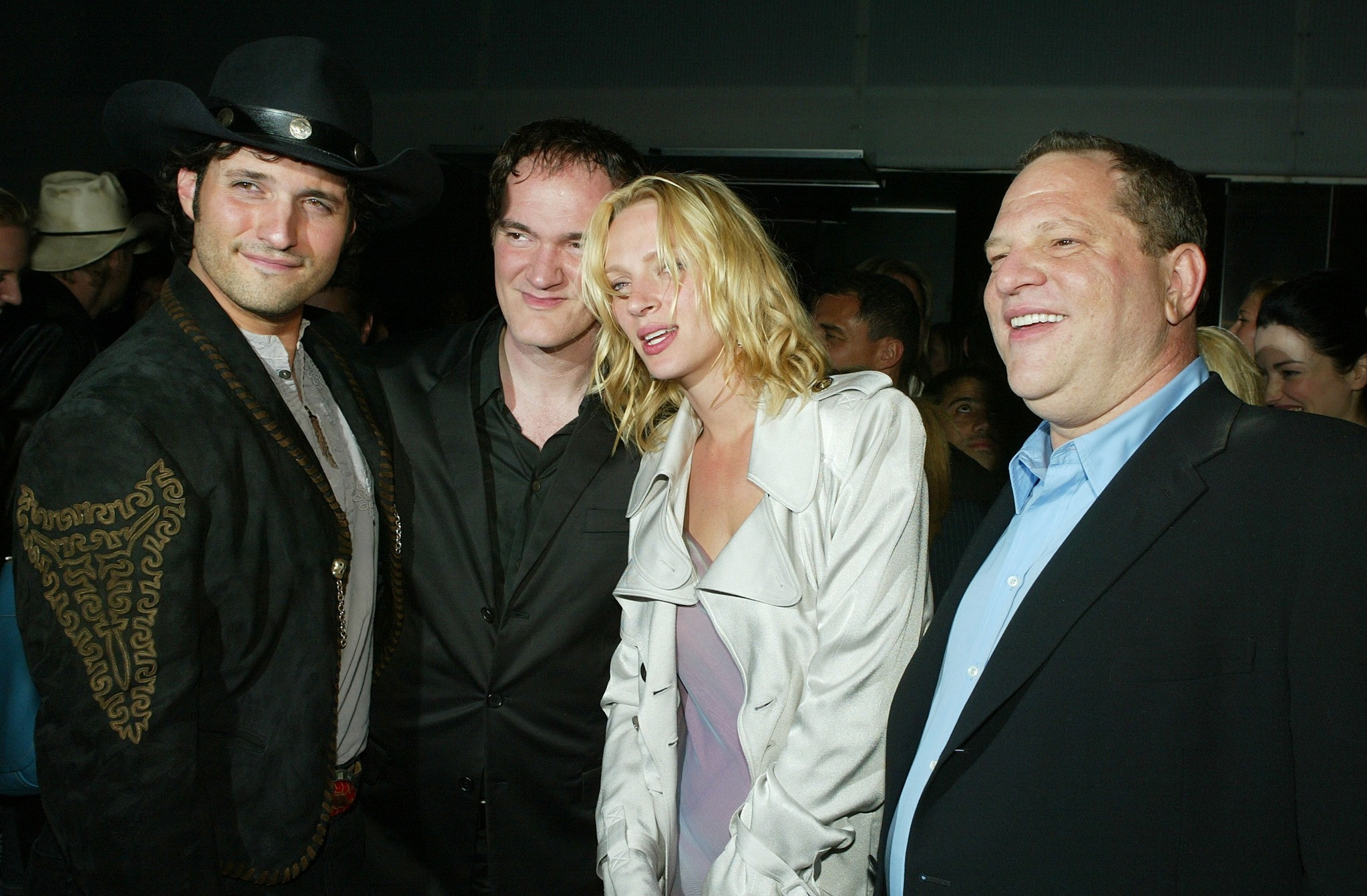 In this file photo taken on April 7, 2004 actress Uma Thurman and Miramaxs' Harvey Weinstein (R) talk at the after-party for Miramaxs' ,Kill Bill Vol. 2, at The Ivar in Los Angeles, California. (AFP Photo)