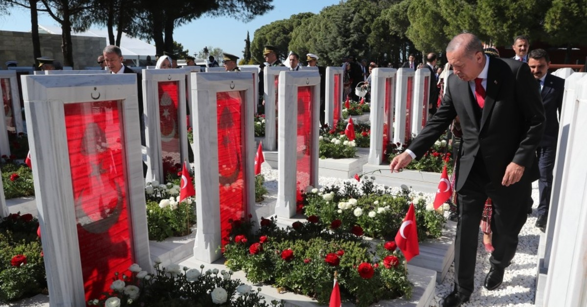 President Recep Tayyip Erdou011fan pays his respects to the martyrs who lost their lives in the Battle of u00c7anakkale, March 18, 2019.