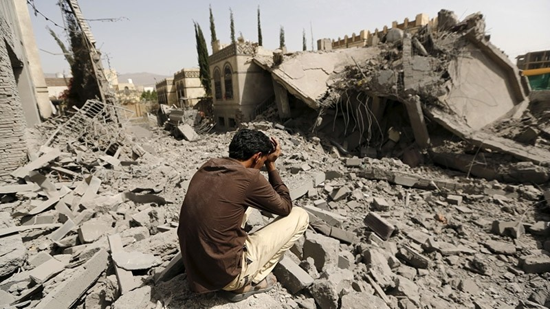 A guard sits on what is left of the house of Brigadier Fouad al-Emad, army commander loyal to the Houthis, after Saudi-led air strikes destroyed it in Sanaa. (Reuters Photo)