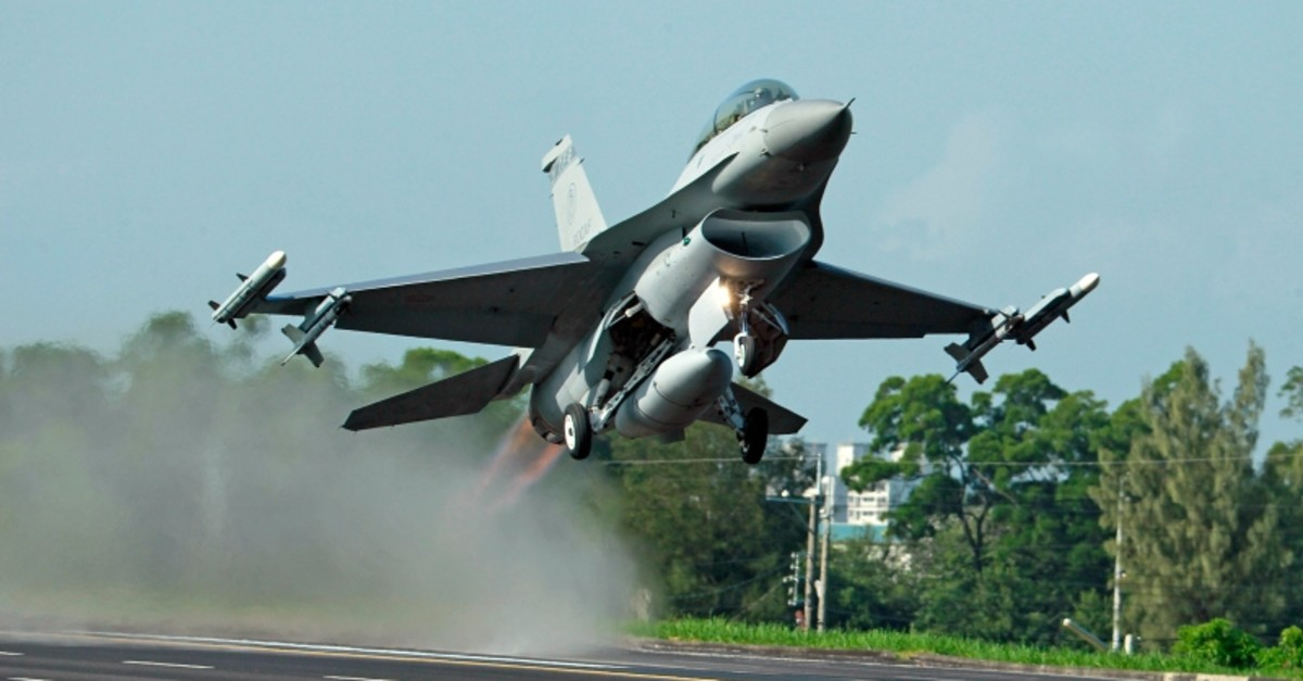 In this Sept. 16, 2014, file photo, a Taiwan Air Force F-16 fighter jet takes off from a closed section of highway during the annual Han Kuang military exercises in Chiayi, central Taiwan. (AP Photo)