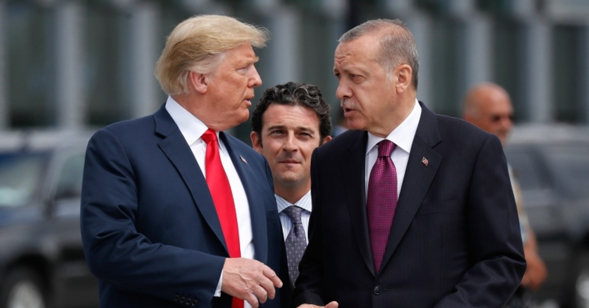 In this Wednesday, July 11, 2018, file photo, President Donald Trump, left, talks with Turkey's President Recep Tayyip Erdogan, as they arrive together for a family photo at a summit of heads of state and government at NATO (AP File Photo)