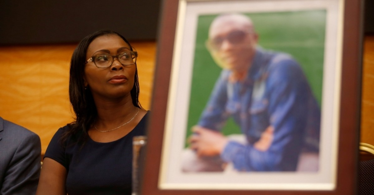 Esther Kabau-Wanyoike, sister of Kenyan George Kabau who died in the Ethiopian Airlines crash, sits next to his picture during a news conference in Nairobi, Kenya April 16, 2019. (Reuters Photo)