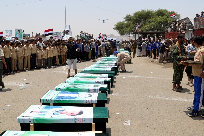 Mourners attend a funeral of people, mainly children, killed in a Saudi-led coalition air strike on a bus in northern Yemen, in Saada, Yemen August 13, 2018. (Reuters Photo)