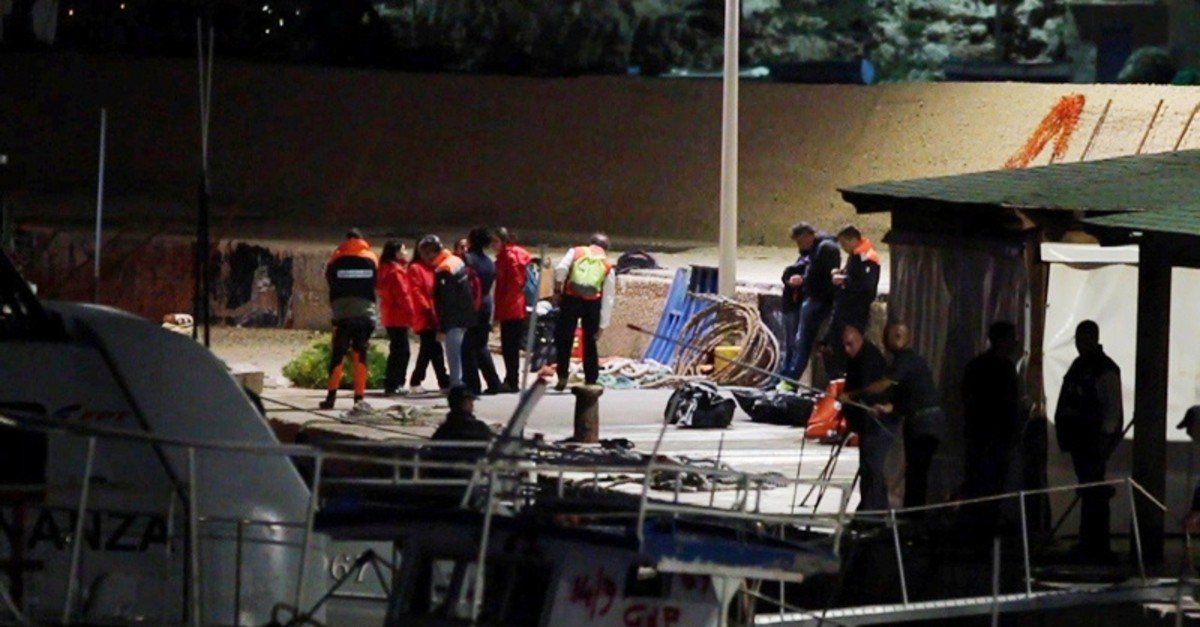 Survivors rescued by the Italian coastguard after their ship carrying some 50 migrants began taking on water, are brought to safety at the port of Lampedusa, Italy October 7, 2019 (Reuters Photo)