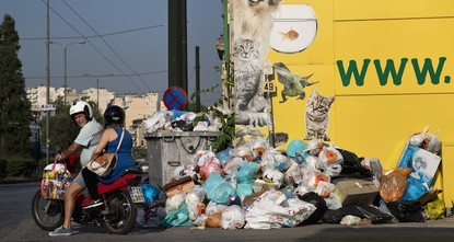 pGreece's government is urging striking garbage collectors to return to work after a 10-day protest has left huge piles of trash around Athens and a heat wave is expected to hit later this...