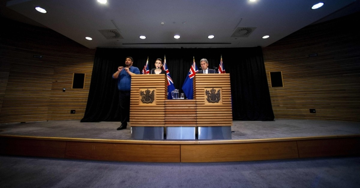 New Zealand Prime Minister Jacinda Ardern (L) and Deputy Prime Minister Winston Peters speak to the media with an interpreter during a Post Cabinet media press conference at Parliament in Wellington on March 18, 2019 (AFP Photo)